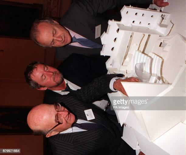 Sir Peter Crill chairman of the Jersey Arts Trust actor John Nettles and TV presenter David Jacobs view the model of the proposed Jersey Opera House...