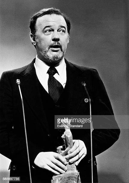 Sir Peter Hall director of the National Theatre accepts a special award marking his 25 years as a director at the Evening Standard Drama Awards held...