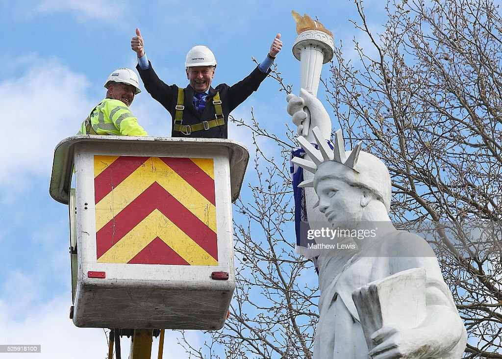 Sir Peter Soulsby, Mayor of Leicester hangs a 10ft Leicester City FC scarf around the Liberty Statue during a Leicester Backing the Blues Campaign in support of Leicester City on April 29, 2016 in Leicester, England.
