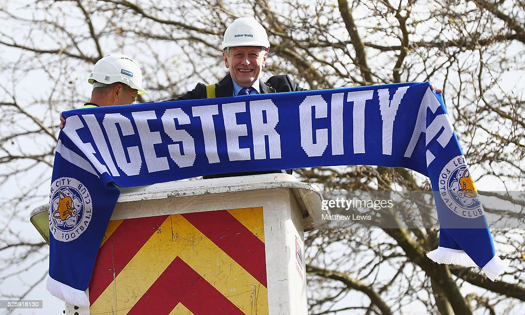 Sir Peter Soulsby, Mayor of Leicester prepares to hang a 10ft Leicester City FC scarf around the Liberty Statue during a Leicester Backing the Blues Campaign in support of Leicester City on April 29, 2016 in Leicester, England.