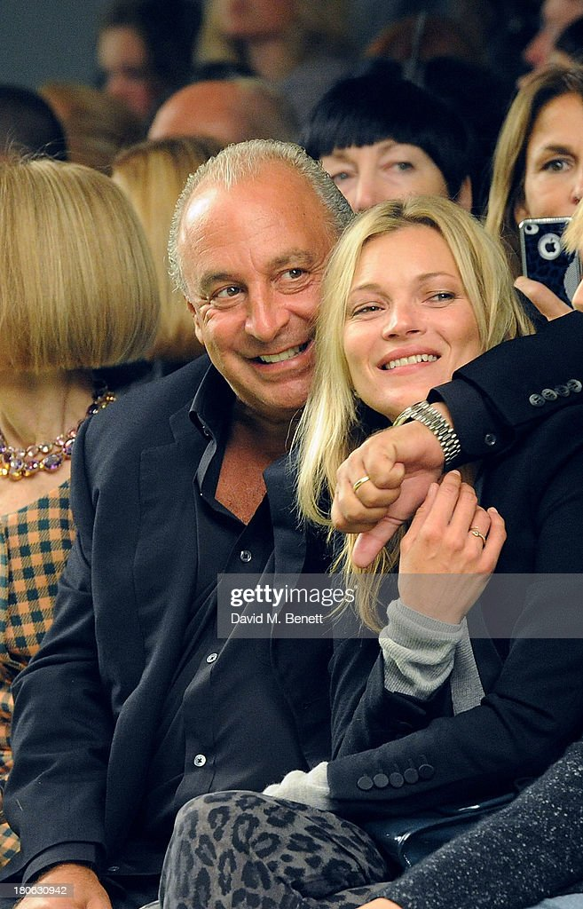Sir Philip Green (L) and <a gi-track='captionPersonalityLinkClicked' href=/galleries/search?phrase=Kate+Moss&family=editorial&specificpeople=201830 ng-click='$event.stopPropagation()'>Kate Moss</a> attend the Unique SS14 runway show during London Fashion Week on September 15, 2013 in London, England.