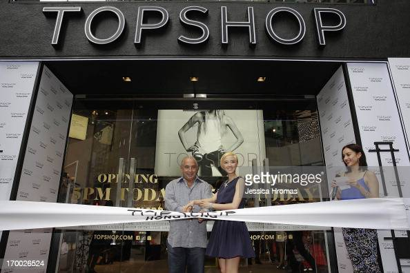 Sir Philip Green the owner of Topshop and Taiwanese actress Gwei Lun Mei cut a ribbon to mark the opening of the new Topshop store as TV host Mandy...