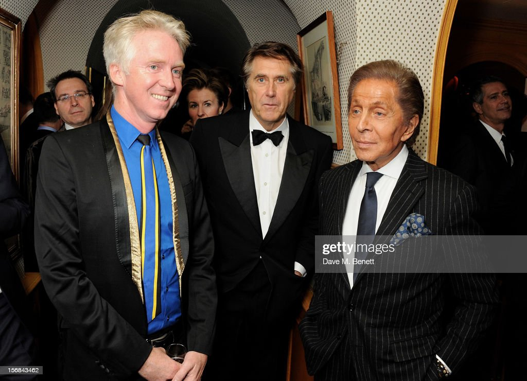 (EMBARGOED FOR PUBLICATION IN UK TABLOID NEWSPAPERS UNTIL 48 HOURS AFTER CREATE DATE AND TIME. MANDATORY CREDIT PHOTO BY DAVE M. BENETT/GETTY IMAGES REQUIRED)(NO GRAZIA OR MONTHLY MAGAZINES) (L to R) Sir <a gi-track='captionPersonalityLinkClicked' href=/galleries/search?phrase=Philip+Treacy+-+Estilista&family=editorial&specificpeople=12819932 ng-click='$event.stopPropagation()'>Philip Treacy</a>, <a gi-track='captionPersonalityLinkClicked' href=/galleries/search?phrase=Bryan+Ferry&family=editorial&specificpeople=206306 ng-click='$event.stopPropagation()'>Bryan Ferry</a> and Valentino Garavani attend a launch hosted by The Vinyl Factory of <a gi-track='captionPersonalityLinkClicked' href=/galleries/search?phrase=Bryan+Ferry&family=editorial&specificpeople=206306 ng-click='$event.stopPropagation()'>Bryan Ferry</a>'s new album 'The Jazz Age' at Annabels on November 22, 2012 in London, England.