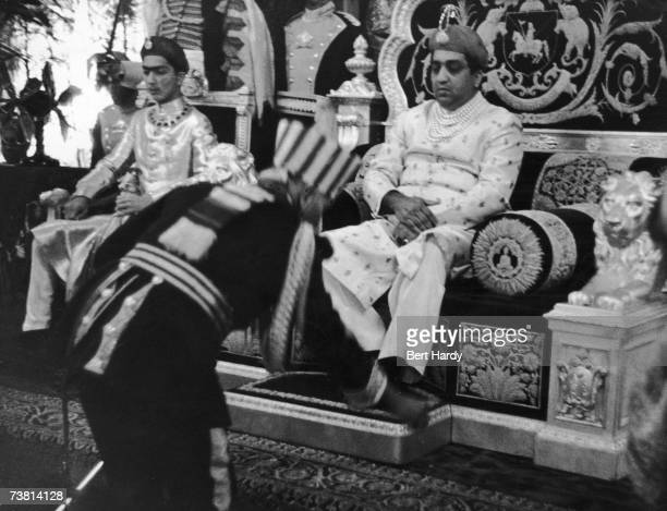 Sir Pratap Sinha Maharaja Gaekwad of Baroda sits on his golden throne in the Great Durbar room at the Laxmi Villas Palace in Baroda 8th March 1947...