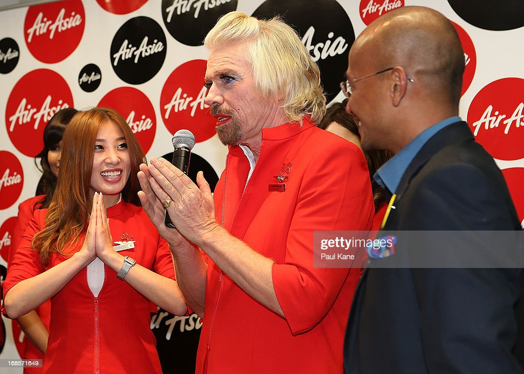 Sir <a gi-track='captionPersonalityLinkClicked' href=/galleries/search?phrase=Richard+Branson&family=editorial&specificpeople=220198 ng-click='$event.stopPropagation()'>Richard Branson</a> addresses passengers before boarding his flight to Kuala Lumpur at Perth International Airport on May 12, 2013 in Perth, Australia. Sir <a gi-track='captionPersonalityLinkClicked' href=/galleries/search?phrase=Richard+Branson&family=editorial&specificpeople=220198 ng-click='$event.stopPropagation()'>Richard Branson</a> lost a friendly bet to AirAsia Group Chief Executive Officer Tony Fernandez after wagering on which of their Formula One racing teams would finish ahead of each other in their debut season of the 2010 Formula One Grand Prix in Abu Dhabi and that the loser would serve as a female flight attendant on board the winner's airline.
