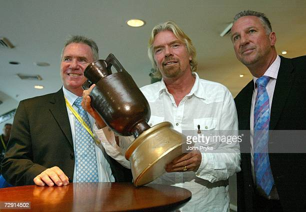 Sir Richard Branson Allan Border of Australia and Ian Botham of England pose with a mock up of the Ashes urn after a news conference during day two...