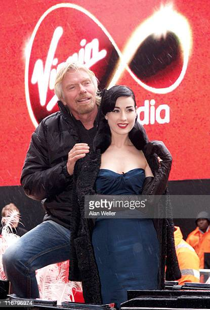 Sir Richard Branson and Dita Von Teese during Virgin Media Photocall at Covent Garden in London Great Britain