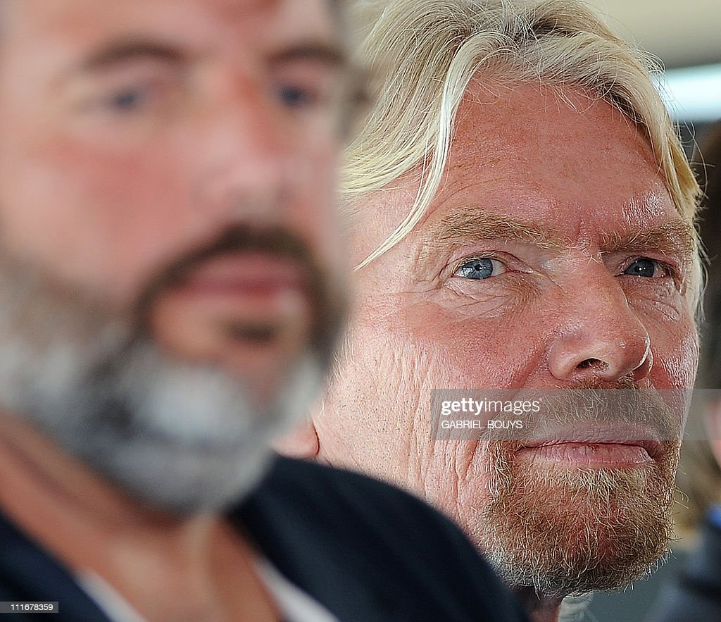 Sir Richard Branson and explorer Chris Welsh (L) attend a press conference in Newport Beach, California on April 5, 2011 to announce plans to take a solo piloted submarine to the deepest points in each of the wolrd's five oceans. The five dives will take place in the Mariana Trench (Pacific Ocean), Puerto Rico Trench (Atlantic Ocean), Diamantina Trench (Indian Ocean), South Sandwich Trench (Southern Ocean) and Molloy Deep (Arctic Ocean). Virgin's Oceanic's first dive will be to the Mariana Trench later in 2011 and a futher four dives are scheduled over the next 24 months.