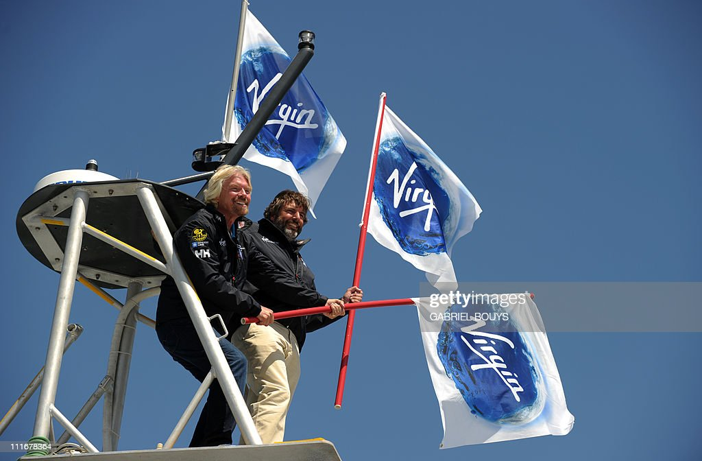 Sir Richard Branson and explorer Chris Welsh (R) attend a press conference in Newport Beach, California on April 5, 2011 to announce plans to take a solo piloted submarine to the deepest points in each of the wolrd's five oceans. The five dives will take place in the Mariana Trench (Pacific Ocean), Puerto Rico Trench (Atlantic Ocean), Diamantina Trench (Indian Ocean), South Sandwich Trench (Southern Ocean) and Molloy Deep (Arctic Ocean). Virgin's Oceanic's first dive will be to the Mariana Trench later in 2011 and a futher four dives are scheduled over the next 24 months. AFP PHOTO / GABRIEL BOUYS