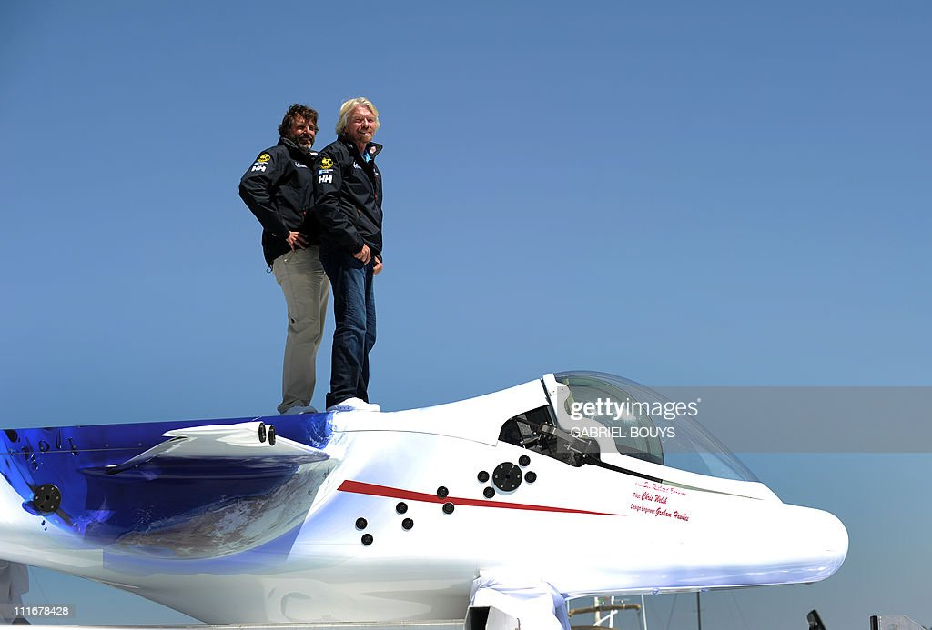 Sir Richard Branson and explorer Chris Welsh (L) attend a press conference in Newport Beach, California on April 5, 2011 to announce plans to take a solo piloted submarine to the deepest points in each of the wolrd's five oceans. The five dives will take place in the Mariana Trench (Pacific Ocean), Puerto Rico Trench (Atlantic Ocean), Diamantina Trench (Indian Ocean), South Sandwich Trench (Southern Ocean) and Molloy Deep (Arctic Ocean). Virgin's Oceanic's first dive will be to the Mariana Trench later in 2011 and a futher four dives are scheduled over the next 24 months. AFP PHOTO / GABRIEL BOUYS