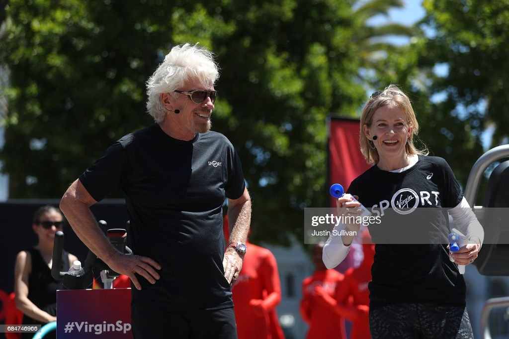 Sir Richard Branson (L) and Virgin Sport CEO Mary Wittenberg (R) speak during a news conference to announce the launch of Virgin Sport on May 18, 2017 in San Francisco, California. Virgin Group founder Sir Richard Branson announced Virgin Sport San Francisco, a half marathon run and fitness festival that is scheduled for October 14.