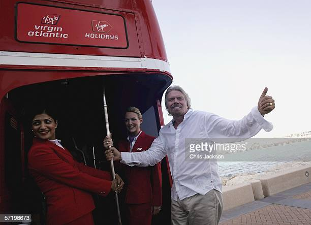 Sir Richard Branson arrives at a press conference at the Burj Al Arab Hotel on a London Bus on the day the inaugural Virgin Atlantic flight from...