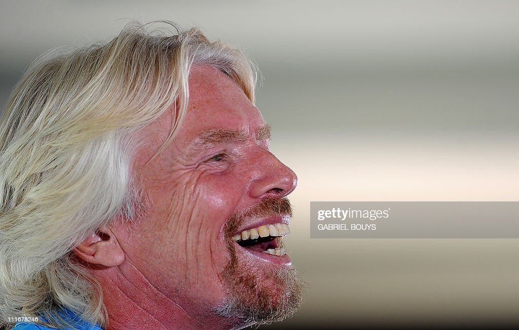 Sir Richard Branson attends a press conference in Newport Beach, California on April 5, 2011 to announce plans to take a solo piloted submarine to the deepest points in each of the wolrd's five oceans. The five dives will take place in the Mariana Trench (Pacific Ocean), Puerto Rico Trench (Atlantic Ocean), Diamantina Trench (Indian Ocean), South Sandwich Trench (Southern Ocean) and Molloy Deep (Arctic Ocean). Virgin's Oceanic's first dive will be to the Mariana Trench later in 2011 and a futher four dives are scheduled over the next 24 months. AFP PHOTO / GABRIEL BOUYS