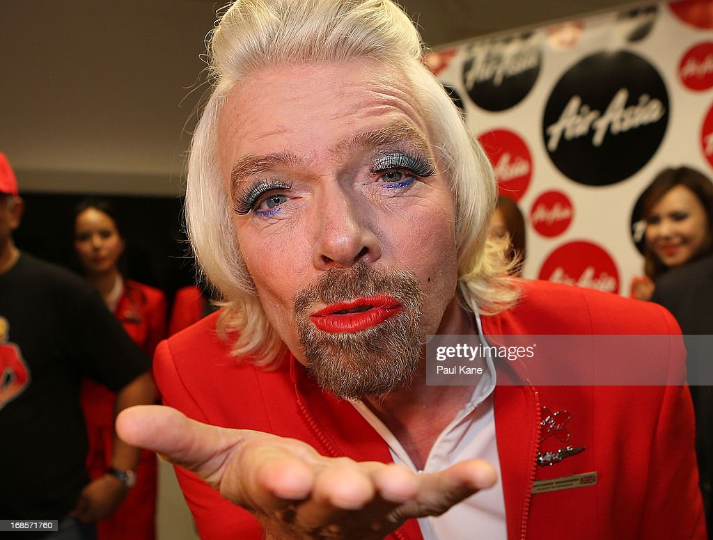 Sir <a gi-track='captionPersonalityLinkClicked' href=/galleries/search?phrase=Richard+Branson&family=editorial&specificpeople=220198 ng-click='$event.stopPropagation()'>Richard Branson</a> blows a kiss before boarding his flight to Kuala Lumpur at Perth International Airport on May 12, 2013 in Perth, Australia. Sir <a gi-track='captionPersonalityLinkClicked' href=/galleries/search?phrase=Richard+Branson&family=editorial&specificpeople=220198 ng-click='$event.stopPropagation()'>Richard Branson</a> lost a friendly bet to AirAsia Group Chief Executive Officer Tony Fernandez after wagering on which of their Formula One racing teams would finish ahead of each other in their debut season of the 2010 Formula One Grand Prix in Abu Dhabi and that the loser would serve as a female flight attendant on board the winner's airline.