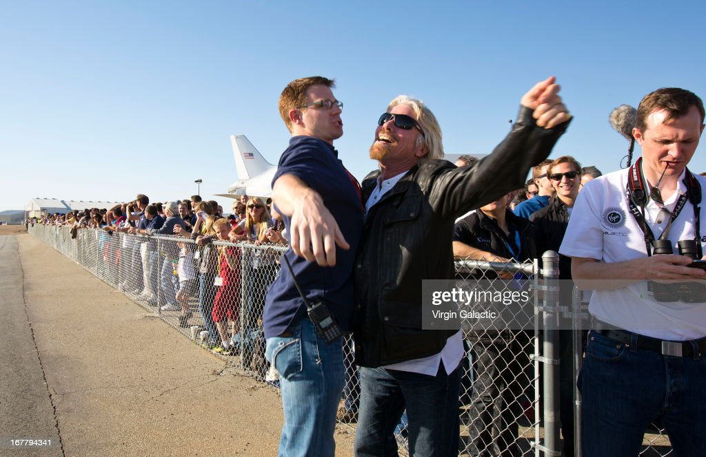 Sir Richard Branson 'chest bumps' Scaled Composites engineer Jason DiVenere following a sucessful rocket motor burn on SpaceShipTwo's first powered flight on April 29, 2013 in Mojave, California. SpaceShipTwo is a private enterprise aircraft, designed to carry paying passengers into space. The spacecraft was dropped from the mothership at high altitude and fired it's engine for a approximate 16-second burn taking the craft through the sound barrier. The hybrid rocket motor is fueled by nitrous oxide and a rubber propellent combination. The motor can be 'shut down' at any time for safety and flight requirement purposes.