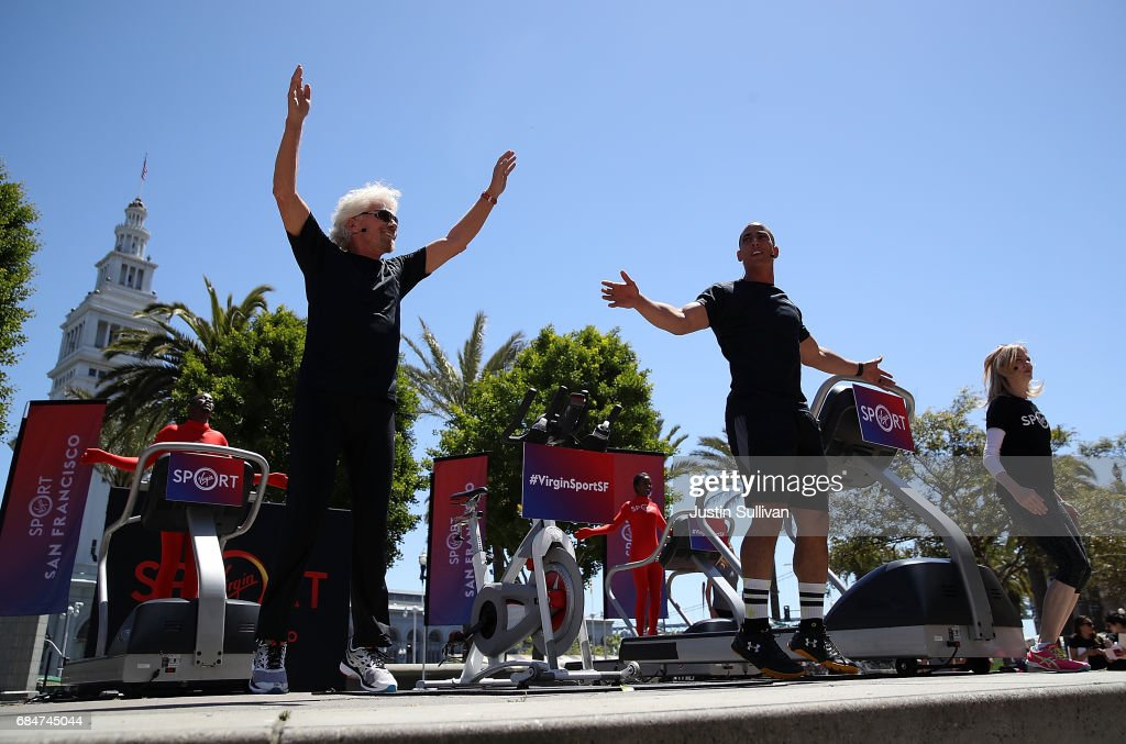 Sir Richard Branson (L) exercises during a news conference to announce the launch of Virgin Sport on May 18, 2017 in San Francisco, California. Virgin Group founder Sir Richard Branson announced Virgin Sport San Francisco, a half marathon run and fitness festival that is scheduled for October 14.