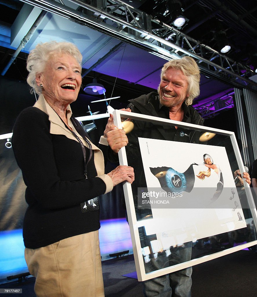 Sir Richard Branson (R), founder of Virgin Galactic with his mother Eve (L), at the unveiling of the Virgin Galactic Spaceship Two and the White Knight carrier aircraft, 23 January 2008, at the America Museum of Natural History in New York. Virgin Galactic will attempt to launch paying customers into sub-orbital space flights with the Spaceship Two. Branson holds a drawing of a logo with his mothers' image to be painted on the spacecraft. AFP PHOTO/Stan HONDA