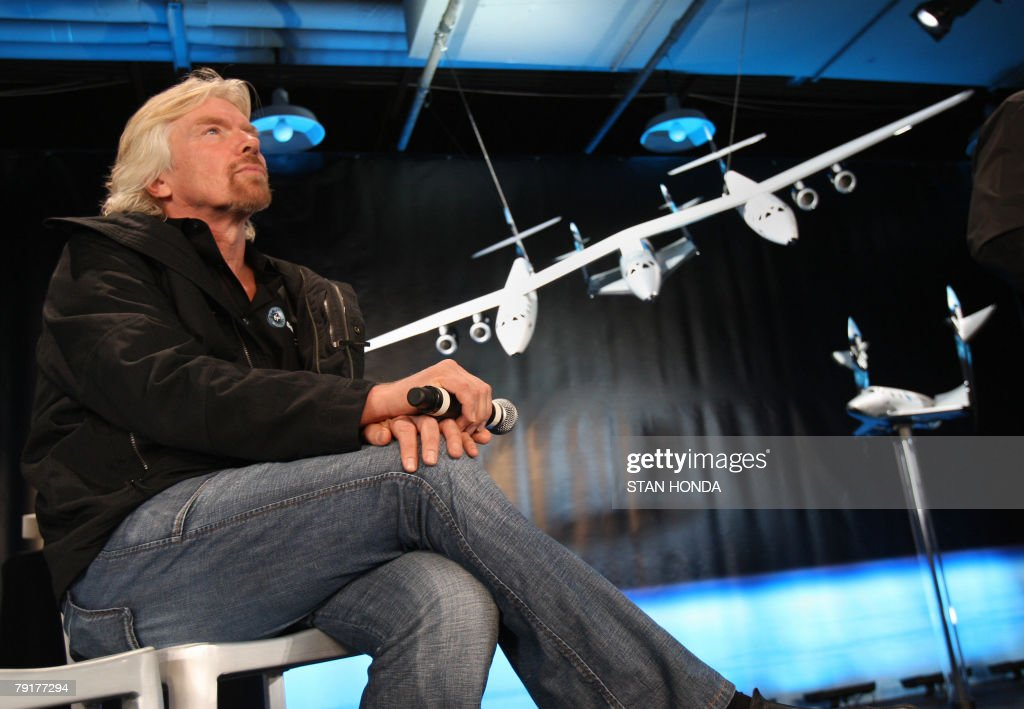 Sir Richard Branson, founder of Virgin Galactic, with models of the White Knight Two carrier aircraft (C) and the Spaceship Two (R) 23 January 2008 at the America Museum of Natural History in New York. Virgin Galactic will attempt to launch paying customers into sub-orbital space flights with the Spaceship Two. AFP PHOTO/Stan HONDA