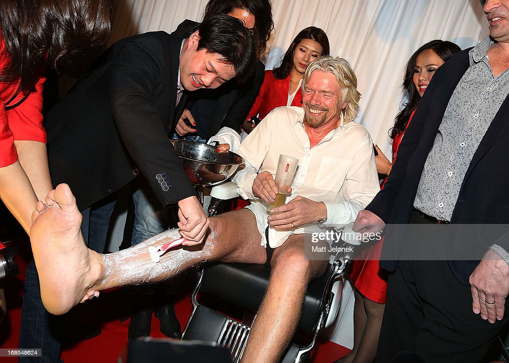 Sir <a gi-track='captionPersonalityLinkClicked' href=/galleries/search?phrase=Richard+Branson&family=editorial&specificpeople=220198 ng-click='$event.stopPropagation()'>Richard Branson</a> gets his legs shaved at the AirAsia Cocktail Party at the QV1 Building on May 11, 2013 in Perth, Australia. Branson will be shaving his legs, wearing make-up and be dressed in stewardess clothing tomorrow after losing a bet with AirAsia CEO, Tony Fernandes over which of their 2010 Formula One teams would be beat the other at the Grand Prix in Abu Dhabi.