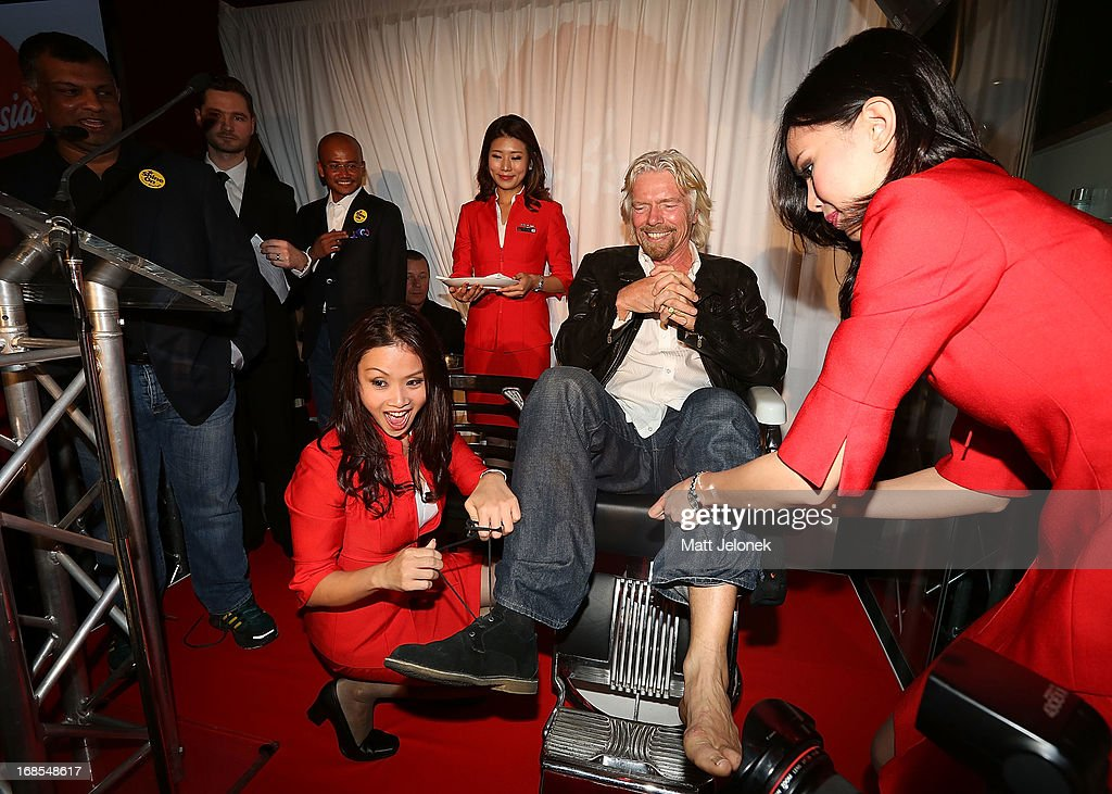 Sir Richard Branson gets ready for his legs to be shaved at the AirAsia Cocktail Party at the QV1 Building on May 11, 2013 in Perth, Australia. Branson will be shaving his legs, wearing make-up and be dressed in stewardess clothing tomorrow after losing a bet with AirAsia CEO, Tony Fernandes over which of their 2010 Formula One teams would be beat the other at the Grand Prix in Abu Dhabi.