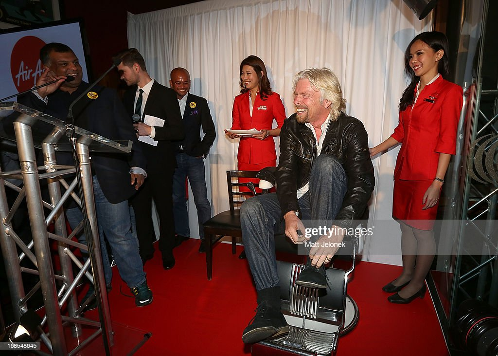 Sir <a gi-track='captionPersonalityLinkClicked' href=/galleries/search?phrase=Richard+Branson&family=editorial&specificpeople=220198 ng-click='$event.stopPropagation()'>Richard Branson</a> gets ready for his legs to be shaved at the AirAsia Cocktail Party at the QV1 Building on May 11, 2013 in Perth, Australia. Branson will be shaving his legs, wearing make-up and be dressed in stewardess clothing tomorrow after losing a bet with AirAsia CEO, Tony Fernandes over which of their 2010 Formula One teams would be beat the other at the Grand Prix in Abu Dhabi.