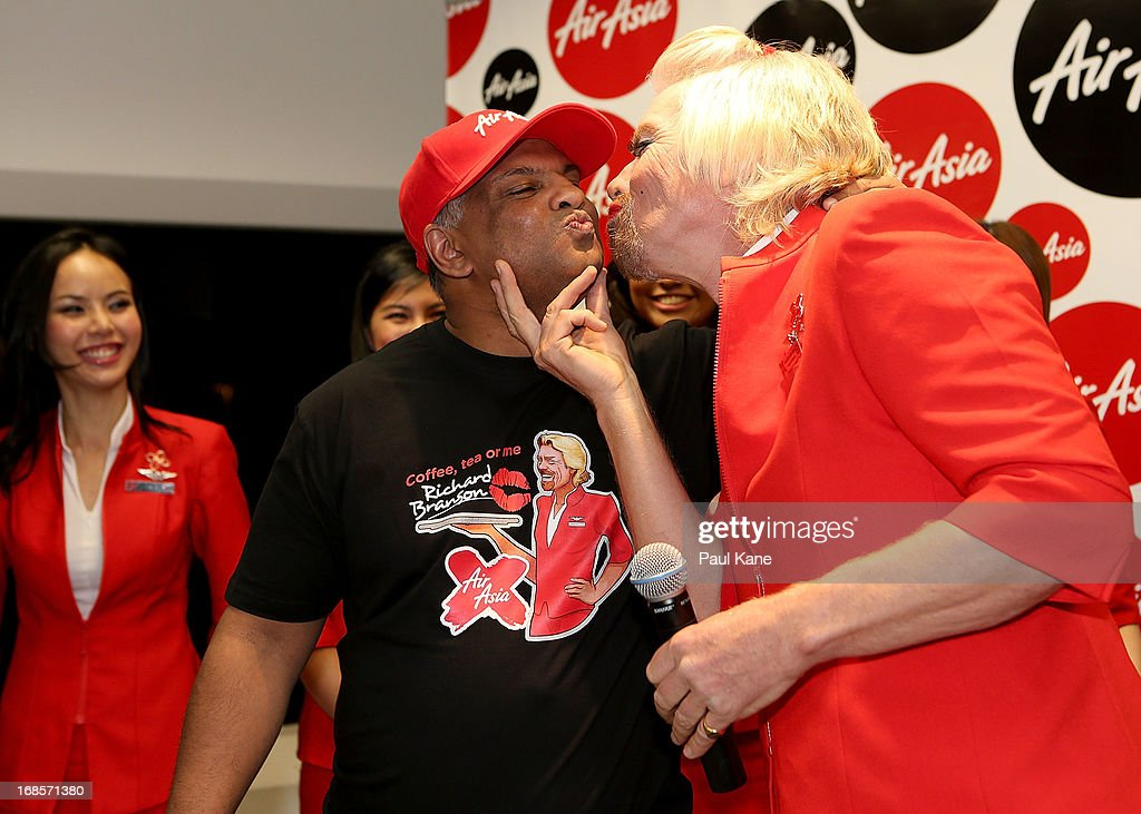 Sir <a gi-track='captionPersonalityLinkClicked' href=/galleries/search?phrase=Richard+Branson&family=editorial&specificpeople=220198 ng-click='$event.stopPropagation()'>Richard Branson</a> gives Tony Fernandes a kiss before boarding his flight to Kuala Lumpur at Perth International Airport on May 12, 2013 in Perth, Australia. Sir <a gi-track='captionPersonalityLinkClicked' href=/galleries/search?phrase=Richard+Branson&family=editorial&specificpeople=220198 ng-click='$event.stopPropagation()'>Richard Branson</a> lost a friendly bet to AirAsia Group Chief Executive Officer Tony Fernandez after wagering on which of their Formula One racing teams would finish ahead of each other in their debut season of the 2010 Formula One Grand Prix in Abu Dhabi and that the loser would serve as a female flight attendant on board the winner's airline.