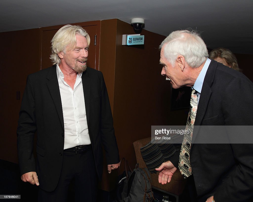 Sir <a gi-track='captionPersonalityLinkClicked' href=/galleries/search?phrase=Richard+Branson&family=editorial&specificpeople=220198 ng-click='$event.stopPropagation()'>Richard Branson</a> greets Captain Planet Foundation Co-Founder and Businessman <a gi-track='captionPersonalityLinkClicked' href=/galleries/search?phrase=Ted+Turner+-+Businessman&family=editorial&specificpeople=203000 ng-click='$event.stopPropagation()'>Ted Turner</a> during the Captain Planet Foundation Benefit Gala at Georgia Aquarium on December 7, 2012 in Atlanta, Georgia.