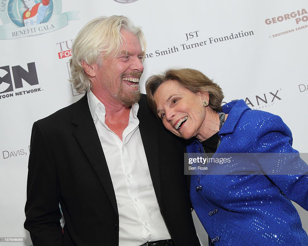 Sir <a gi-track='captionPersonalityLinkClicked' href=/galleries/search?phrase=Richard+Branson&family=editorial&specificpeople=220198 ng-click='$event.stopPropagation()'>Richard Branson</a> greets Oceanographer Dr. Sylvia Earle on the green carpet during the Captain Planet Foundation Benefit Gala at Georgia Aquarium on December 7, 2012 in Atlanta, Georgia.