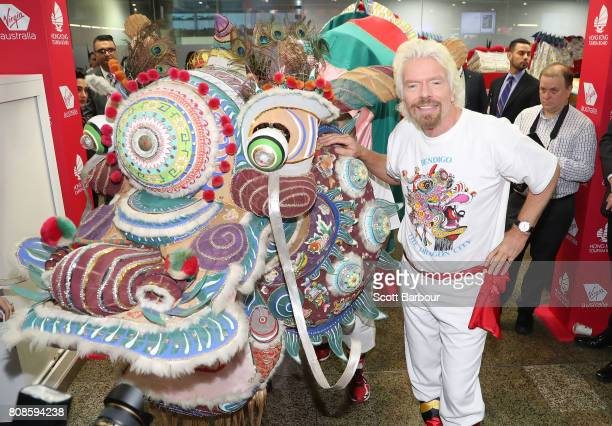 Sir Richard Branson launches Virgin Australia's inaugural Melbourne to Hong flights by carrying the head of 32metre local Bendigo dragon Yar Loong in...