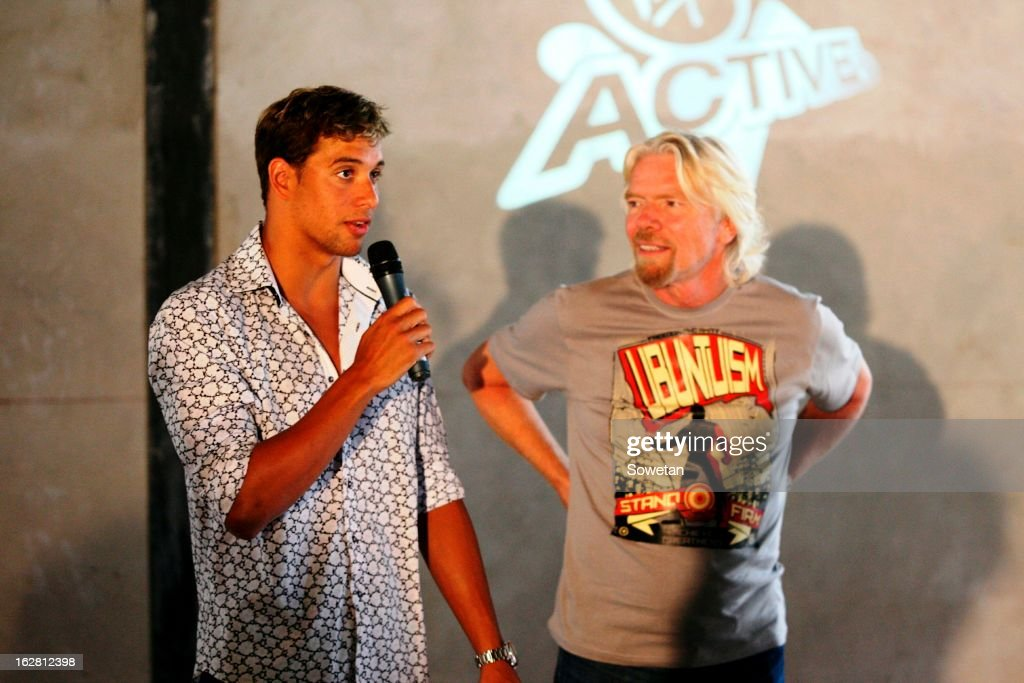 Sir <a gi-track='captionPersonalityLinkClicked' href=/galleries/search?phrase=Richard+Branson&family=editorial&specificpeople=220198 ng-click='$event.stopPropagation()'>Richard Branson</a> (R) listens as Chad Le Clos speaks, during his visit to the new Virgin Active Sandton under construction on February 27, 2013, in Johannesburg, South Africa.