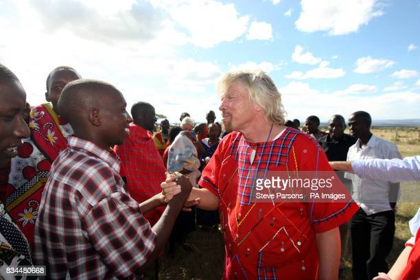 Sir Richard Branson meets the local community at the official opening of a new school building in a Maasai Mara village in Kenya which was built by...