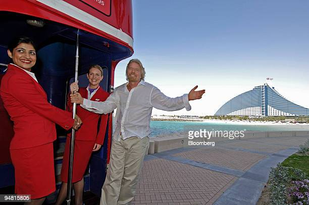 Sir Richard Branson of Virgin Atlantic arrives to his press conference at the Burj Al Arab Hotel aboard a doubledecker bus in Dubai United Arab...