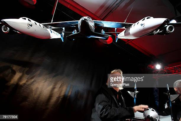 Sir Richard Branson of Virgin Atlantic stands under a model of a spaceship unveiled at a news conference January 23 2008 in New York City Branson...