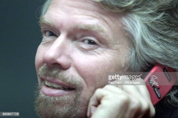 Sir Richard Branson officially launches his Virgin Mobile telephone brand in Belfast Northern Ireland Virgin which uses the One2One network of masts...