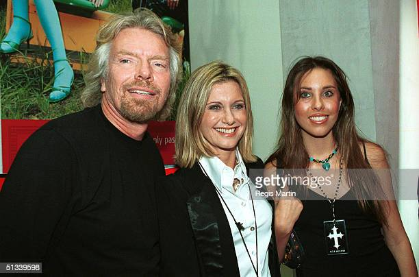 APRIL 2002 Sir Richard Branson Olivia Newton John and daughter Chloe Lattanzi The party for the launch of the new Virgin Megastor in MelbourneThe...