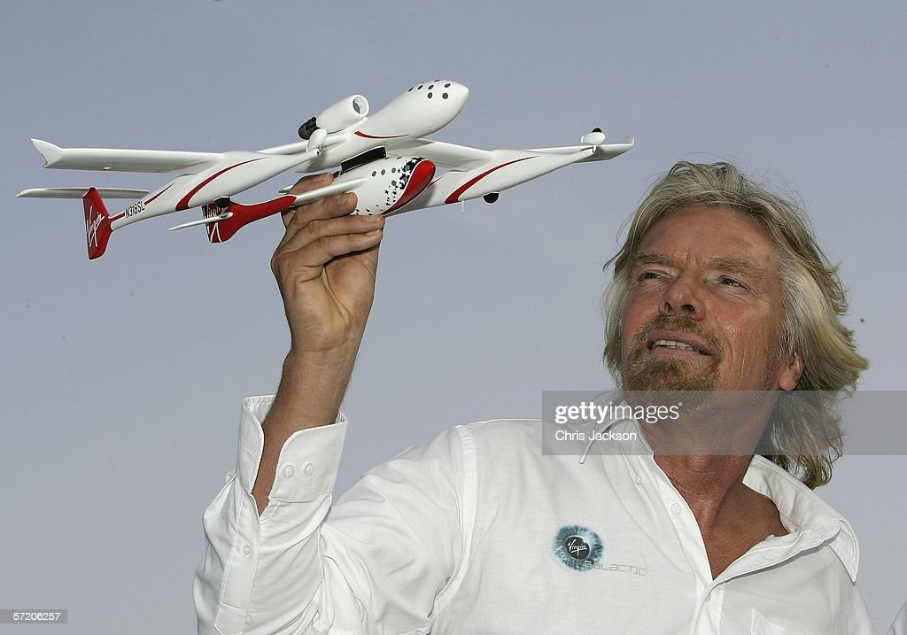 Sir Richard Branson poses a model of 'Spaceship One' after a Press conference for Virgins new service Virgin Galactic at Emirates Towers on March 29, 2006 in Dubai United Arab Emirates. Alex Tai will be the first person to pilot the new spaceship and is currently Virgin Galactic operations director. Virgin Galactic plans to offer sub-orbital spaceflights, with the first flights being planned to begin in 2008.