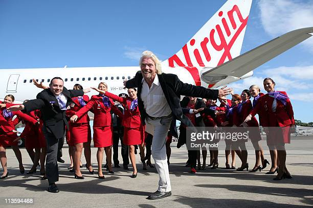 Sir Richard Branson poses alongside Virgin Australia staff in front of its new A330 plane at Sydney Airport on May 4 2011 in Sydney Australia