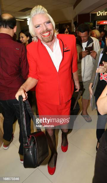 Sir Richard Branson poses at Perth International Airport on May 12 2013 in Perth Australia Branson shaved his legs wore make up and dressed in...