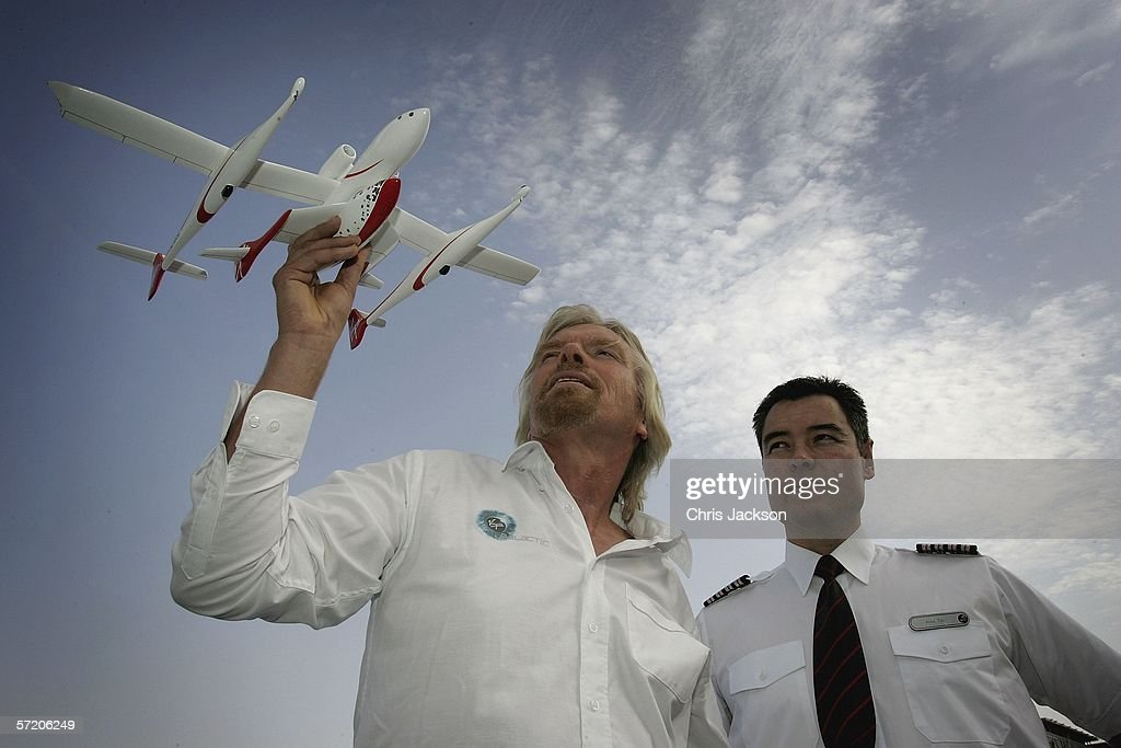 Sir Richard Branson (L) poses with Alex Tai and a model of Spaceship One after a Press conference for Virgins new service Virgin Galactic at Emirates Towers on March 29, 2006 in Dubai United Arab Emirates. Alex Tai will be the first person to pilot the new spaceship and is currently Virgin Galactic operations director. Virgin Galactic plans to offer sub-orbital spaceflights, with the first flights being planned to begin in 2008.