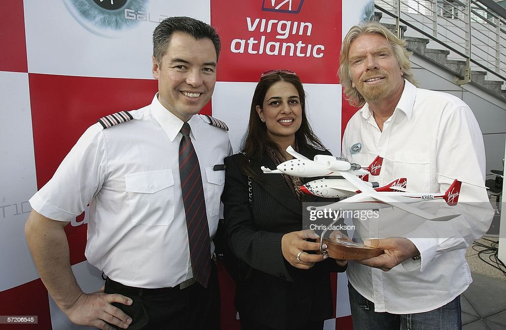 Sir Richard Branson poses with Pilot Alex Tai (L) and Namira Salim (C), the first Dubai founder Astronaut with a model of Spaceship One after a Press conference for Virgins new service Virgin Galactic at Emirates Towers on March 29, 2006 in Dubai, United Arab Emirates. Alex Tai will be the first person to pilot the new spaceship and is currently Virgin Galactic operations director. Virgin Galactic plans to offer sub-orbital spaceflights, with the first flights being planned to begin in 2008.