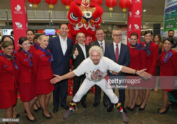 Sir Richard Branson poses with Steven Ciobo Minister for Trade Tourism and Investment John Borghetti Virgin Australia Group CEO and Managing Director...