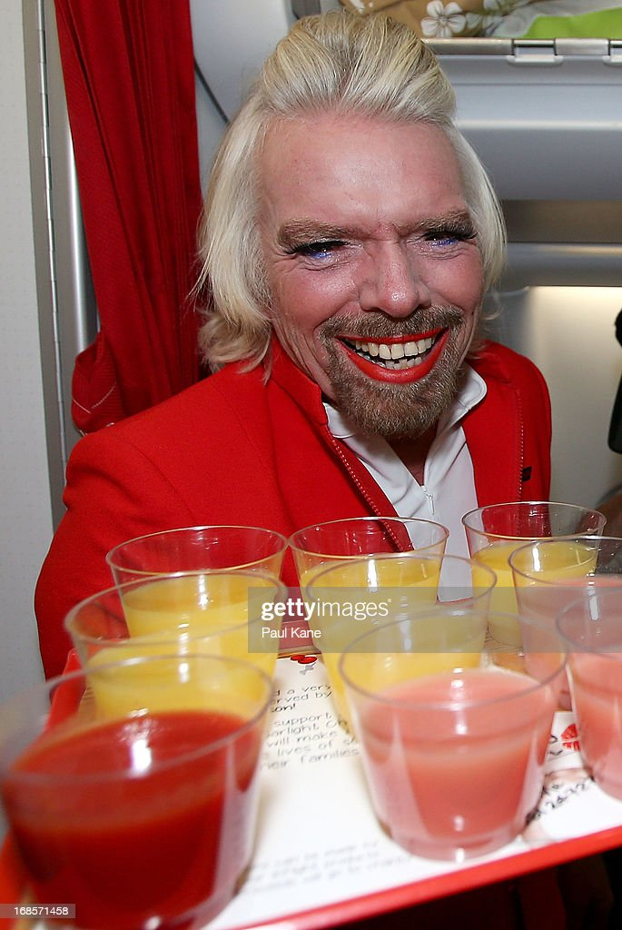 Sir <a gi-track='captionPersonalityLinkClicked' href=/galleries/search?phrase=Richard+Branson&family=editorial&specificpeople=220198 ng-click='$event.stopPropagation()'>Richard Branson</a> serves drinks prior to his flight to Kuala Lumpur at Perth International Airport on May 12, 2013 in Perth, Australia. Sir <a gi-track='captionPersonalityLinkClicked' href=/galleries/search?phrase=Richard+Branson&family=editorial&specificpeople=220198 ng-click='$event.stopPropagation()'>Richard Branson</a> lost a friendly bet to AirAsia Group Chief Executive Officer Tony Fernandez after wagering on which of their Formula One racing teams would finish ahead of each other in their debut season of the 2010 Formula One Grand Prix in Abu Dhabi and that the loser would serve as a female flight attendant on board the winner's airline.