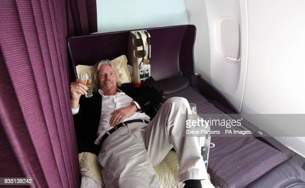 Sir Richard Branson sits on the business class flat bed during the first V Australia flight from Sydney Australia to Los Angeles in the United States...