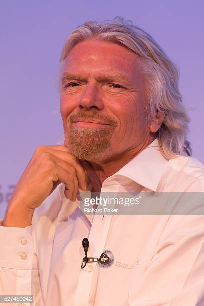 Sir Richard Branson speaks to audience during a Virgin Galactic space tourism presentation at Farnborough Air Show Virgin Galactic is a company...