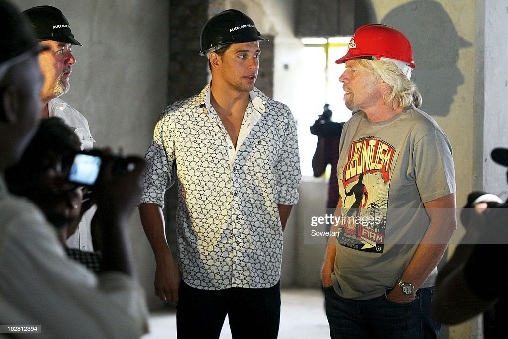 Sir <a gi-track='captionPersonalityLinkClicked' href=/galleries/search?phrase=Richard+Branson&family=editorial&specificpeople=220198 ng-click='$event.stopPropagation()'>Richard Branson</a> (R) speaks to Chad Le Clos during his visit to the new Virgin Active Sandton under construction on February 27, 2013, in Johannesburg, South Africa.