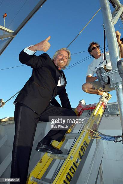 Sir Richard Branson stands on the roof of the Palms Casino Resort Fantasy Tower before descending 350 feet down the side of the casino to promote the...