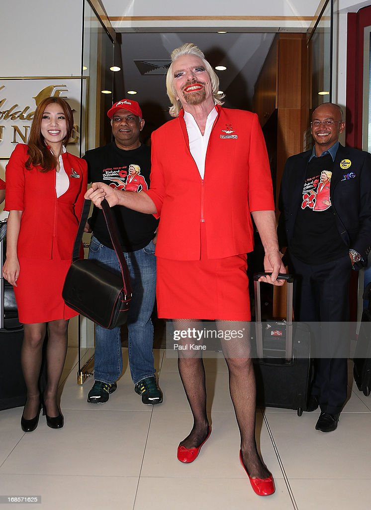 Sir <a gi-track='captionPersonalityLinkClicked' href=/galleries/search?phrase=Richard+Branson&family=editorial&specificpeople=220198 ng-click='$event.stopPropagation()'>Richard Branson</a> walks from a VIP lounge with Tony Fernandes prior to their flight to Kuala Lumpur at Perth International Airport on May 12, 2013 in Perth, Australia. Sir <a gi-track='captionPersonalityLinkClicked' href=/galleries/search?phrase=Richard+Branson&family=editorial&specificpeople=220198 ng-click='$event.stopPropagation()'>Richard Branson</a> lost a friendly bet to AirAsia Group Chief Executive Officer Tony Fernandez after wagering on which of their Formula One racing teams would finish ahead of each other in their debut season of the 2010 Formula One Grand Prix in Abu Dhabi and that the loser would serve as a female flight attendant on board the winner's airline.