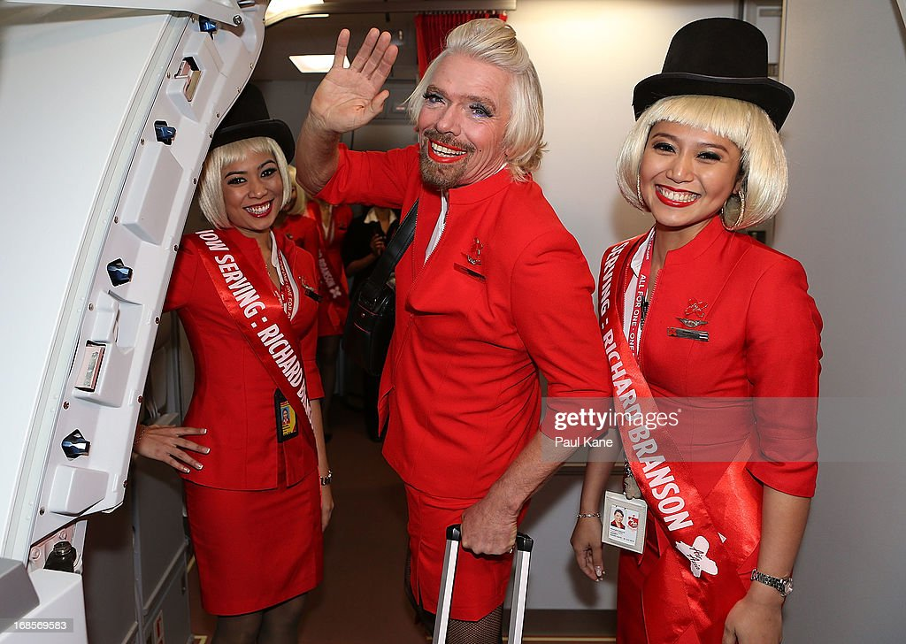 Sir <a gi-track='captionPersonalityLinkClicked' href=/galleries/search?phrase=Richard+Branson&family=editorial&specificpeople=220198 ng-click='$event.stopPropagation()'>Richard Branson</a> waves farewell prior to his flight to Kuala Lumpur at Perth International Airport on May 12, 2013 in Perth, Australia. Sir <a gi-track='captionPersonalityLinkClicked' href=/galleries/search?phrase=Richard+Branson&family=editorial&specificpeople=220198 ng-click='$event.stopPropagation()'>Richard Branson</a> lost a friendly bet to AirAsia Group Chief Executive Officer Tony Fernandez after wagering on which of their Formula One racing teams would finish ahead of each other in their debut season of the 2010 Formula One Grand Prix in Abu Dhabi and that the loser would serve as a female flight attendant on board the winner's airline.