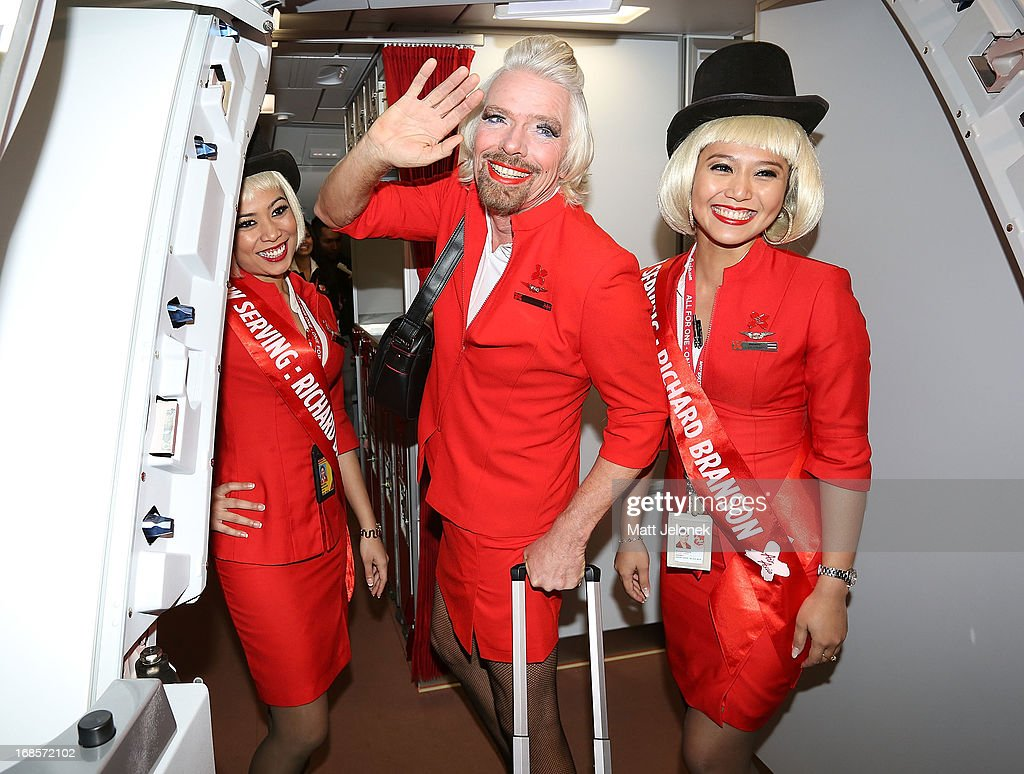 Sir <a gi-track='captionPersonalityLinkClicked' href=/galleries/search?phrase=Richard+Branson&family=editorial&specificpeople=220198 ng-click='$event.stopPropagation()'>Richard Branson</a> with AirAsia Stewardess' at Perth International Airport on May 12, 2013 in Perth, Australia. Branson shaved his legs, wore make up and dressed in stewardess clothing after losing a bet with AirAsia CEO, Tony Fernandes over which of their 2010 Formula One teams would be beat the other at the Grand Prix in Abu Dhabi.