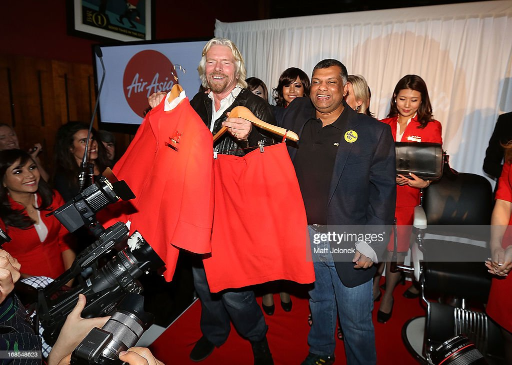 Sir <a gi-track='captionPersonalityLinkClicked' href=/galleries/search?phrase=Richard+Branson&family=editorial&specificpeople=220198 ng-click='$event.stopPropagation()'>Richard Branson</a> with Tony Fernandes attend the AirAsia Cocktail Party at the QV1 Building on May 11, 2013 in Perth, Australia. Branson will be shaving his legs, wearing make-up and be dressed in stewardess clothing tomorrow after losing a bet with AirAsia CEO, Tony Fernandes over which of their 2010 Formula One teams would be beat the other at the Grand Prix in Abu Dhabi.
